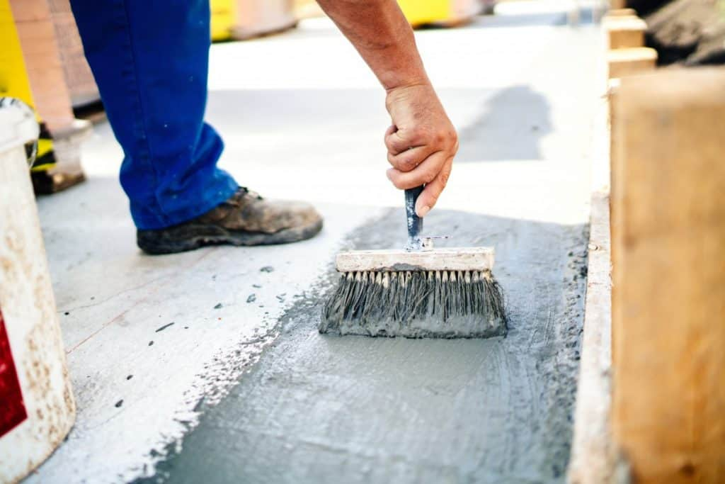 Applying concrete sealer with a brush