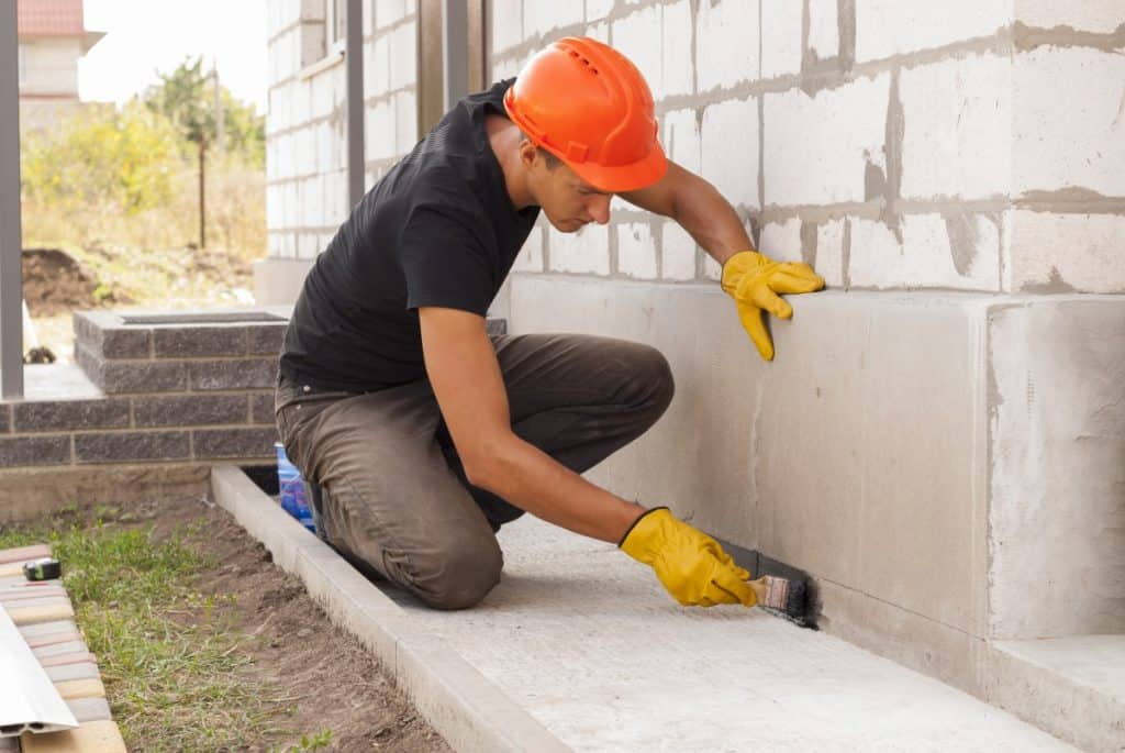 Man working with finish on concrete