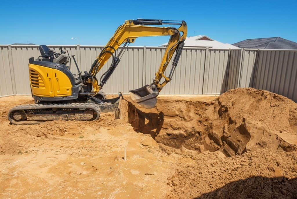 Preparing a site before building a concrete in-ground pool