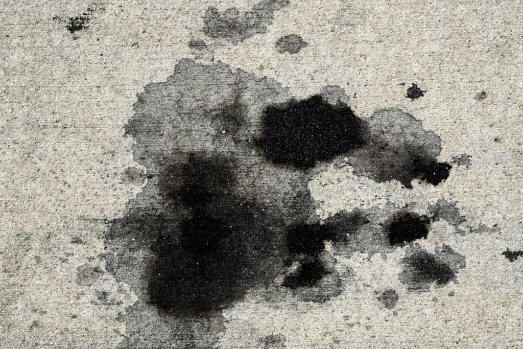 Semi-permanent stain on concrete which could be removed with a concrete cleaner