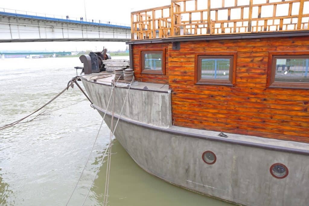 Concrete boat floating on water