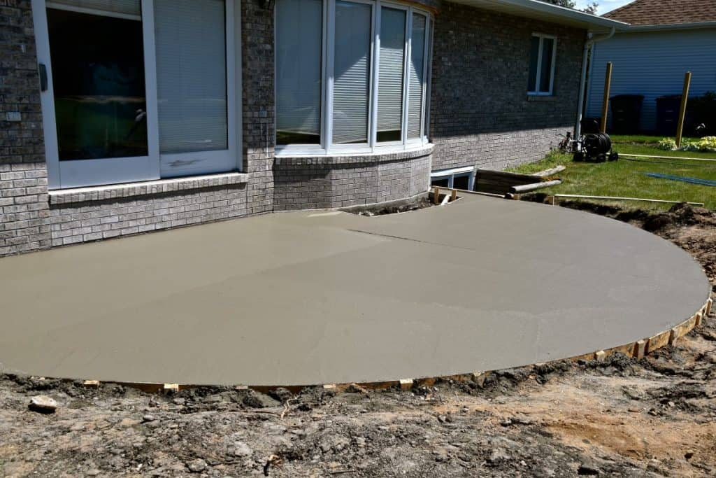 A simple and cheap concrete patio that can be made DIY style.
