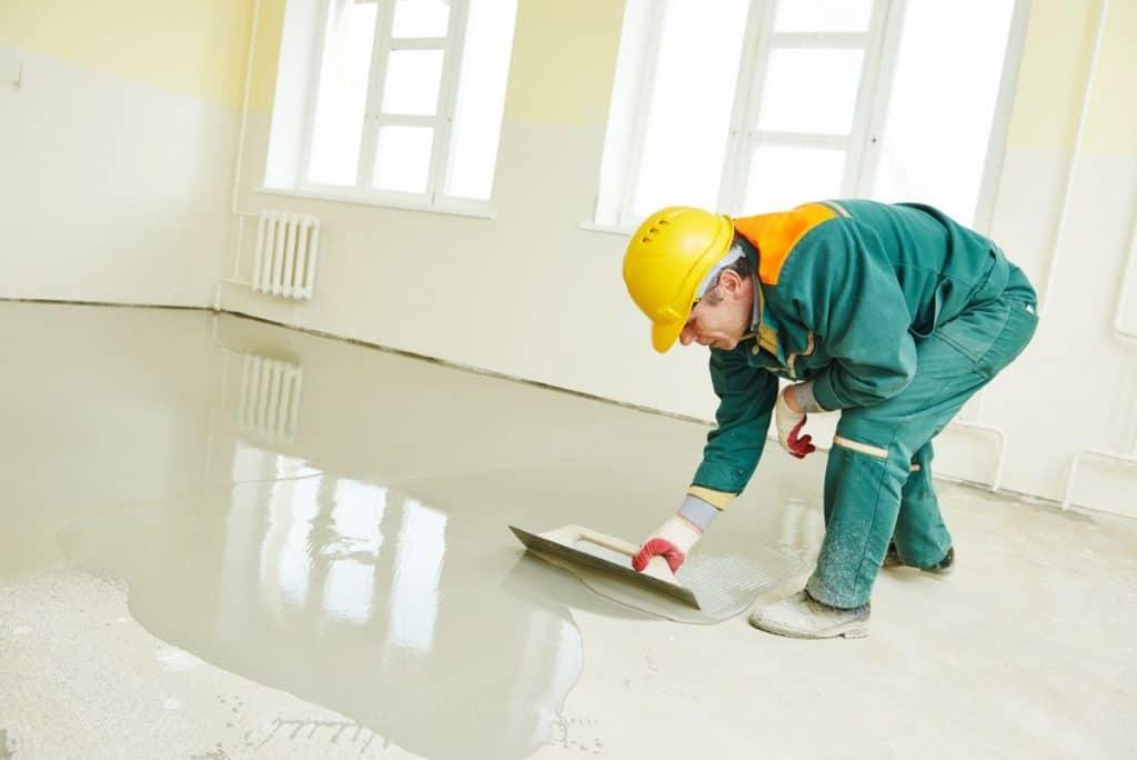 Concrete worker fixing floor