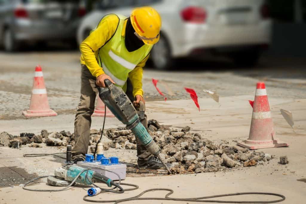 Man removing old concrete