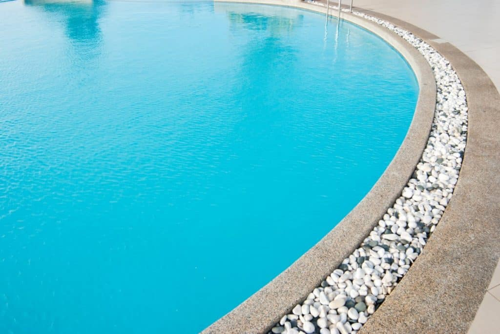 Nice pool decking with concrete and stone combo