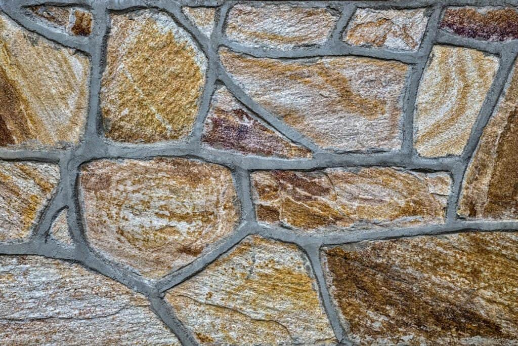Veeners of stone covering a concrete wall