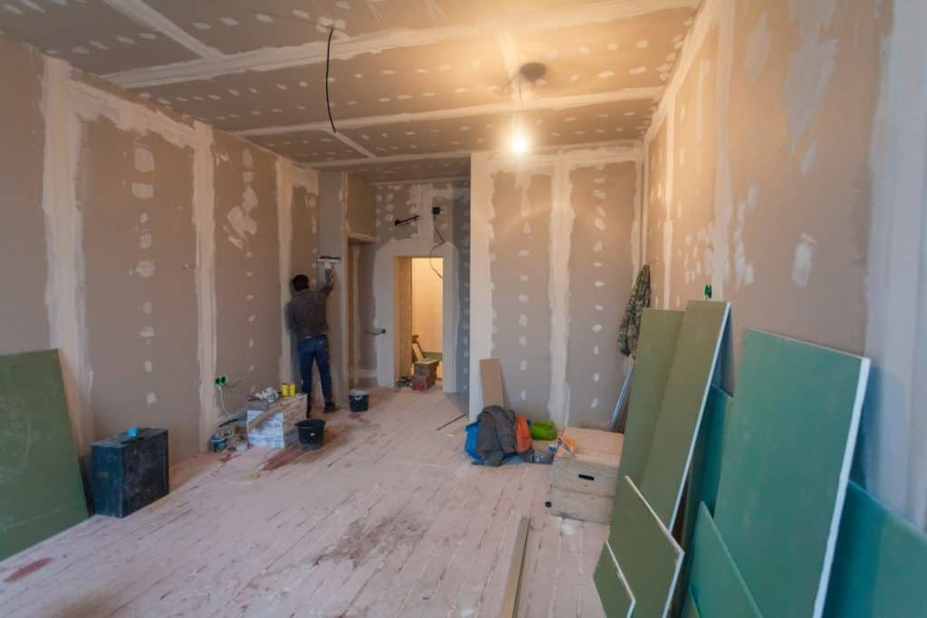 Drywall installed to cover concrete walls