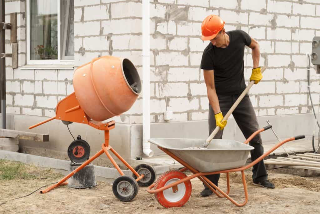 Man mixing large quantities of concrete