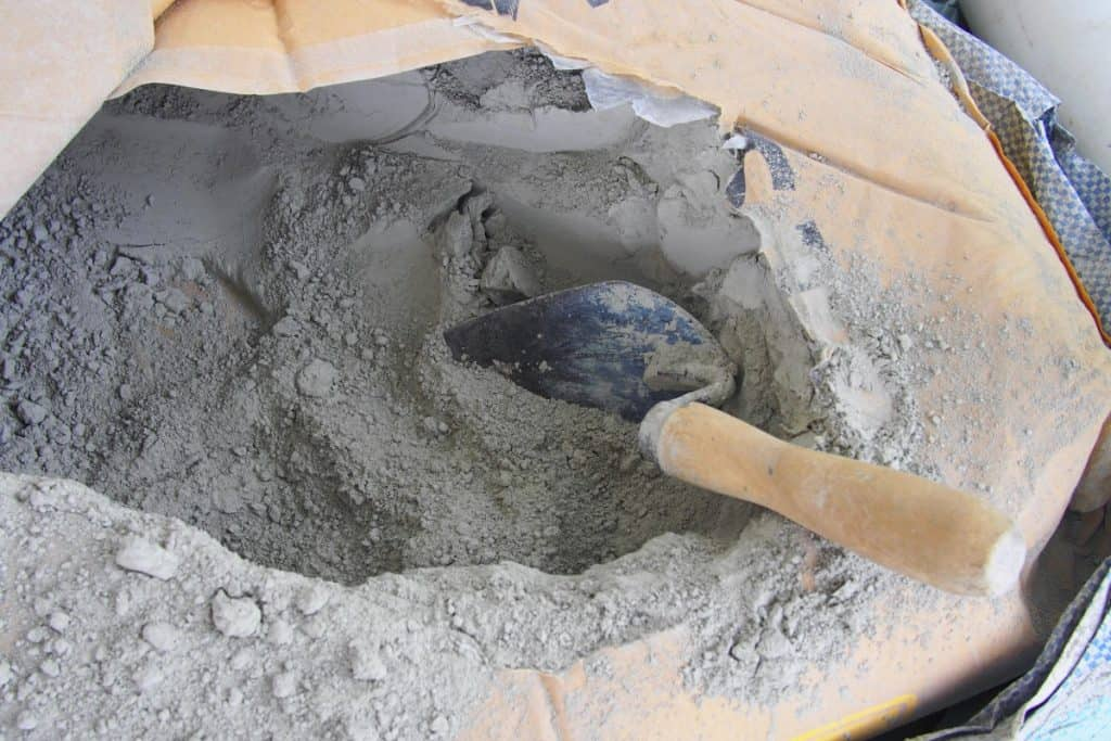 An opened bag of concrete mix