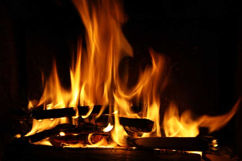 Fire burning in concrete fireplace