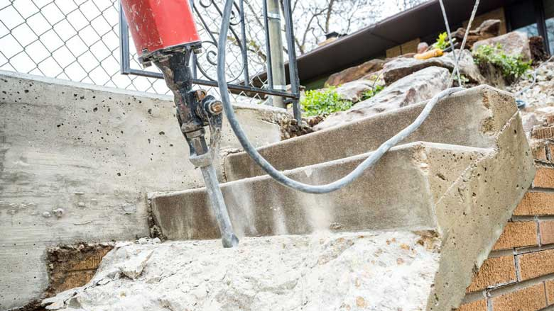 Breaking up concrete steps with a jackhammer