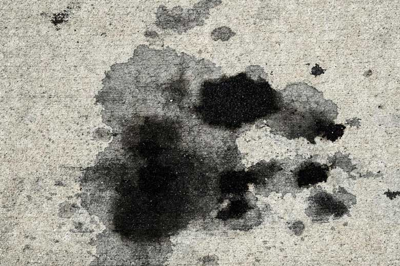 Oil stain on concrete driveway